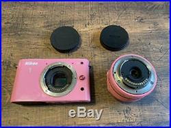 Nikon 1j1 digital camera with color pink lens, SD card, cap